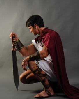 Free Stock Photo of Roman Soldier Kneeling with Sword