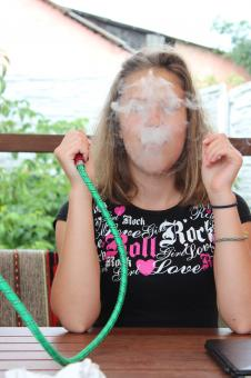 Free Stock Photo of Girl Smoking Shisha