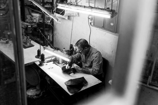 Free Stock Photo of Man Working on Sewing