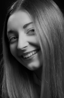 Free Stock Photo of Happy Young Woman - Black and White Portrait