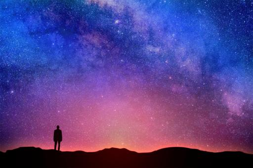 Free Stock Photo of Lonely Man Under Night Sky - Starry Sky Over the Horizon