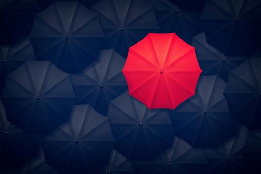 Free Stock Photo of Red Umbrella Contrasting With Black Umbrellas - Be Different