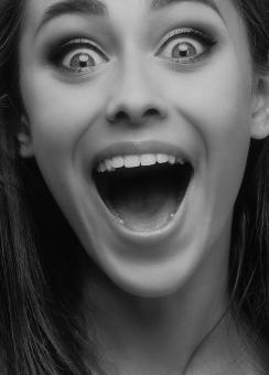 Free Stock Photo of Happy Girl with Open Eyes and Mouth - Monochrome