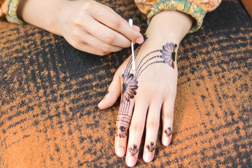 Free Stock Photo of Girl Doing Henna Design