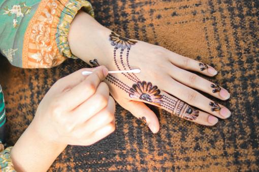 Free Stock Photo of Girl Creating Henna Tattoo Design
