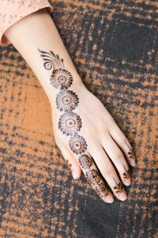 Free Stock Photo of Female Hand with Henna Tattoo Design