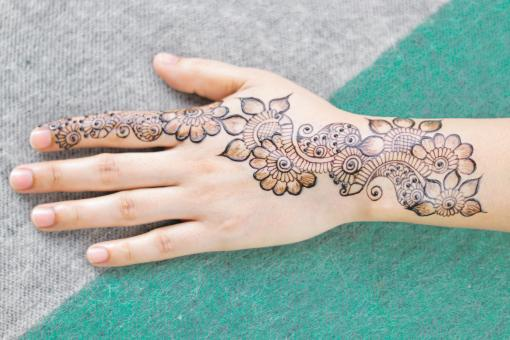 Free Stock Photo of Beautiful Henna Tattoo on Woman Hand