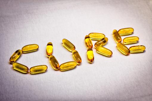 Free Stock Photo of Vitamin Captules Spelling the Word Cure