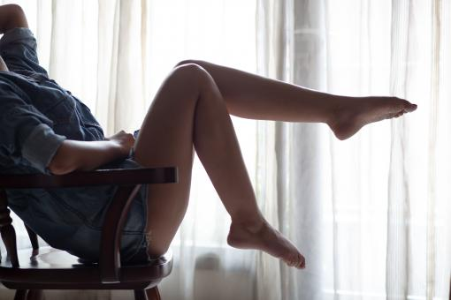 Free Stock Photo of Woman posing and showing legs on chair