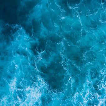 Free Stock Photo of Aerial view to ocean waves. Blue water background