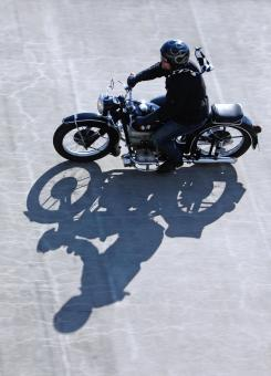 Free Stock Photo of Biker and Shadow
