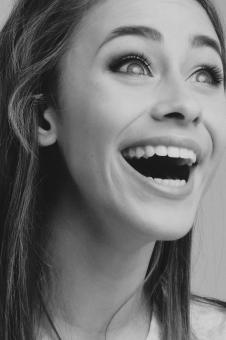 Free Stock Photo of Laughing Woman Portrait - Monochrome