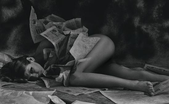 Free Stock Photo of Girl Lying in Paper - Monochrome