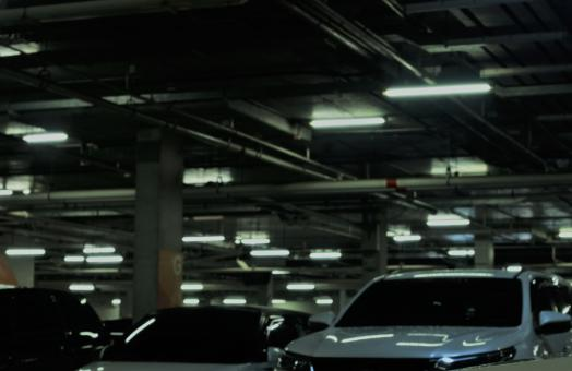 Free Stock Photo of Cars in a dark underground parking lot