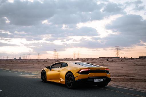 Free Stock Photo of Yellow Sports Car on Road