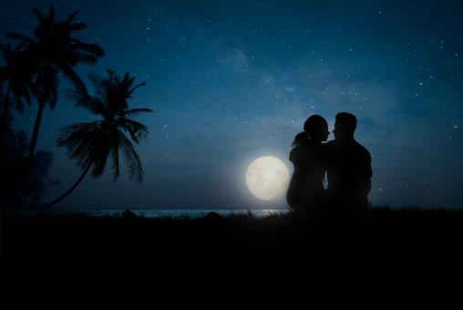 Free Stock Photo of Lovers at Night on the Beach - Romantic Couple