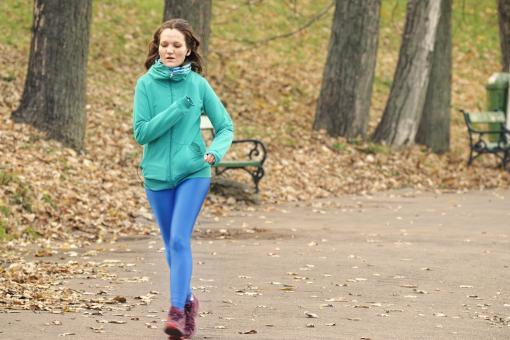 Free Stock Photo of Young woman running in park