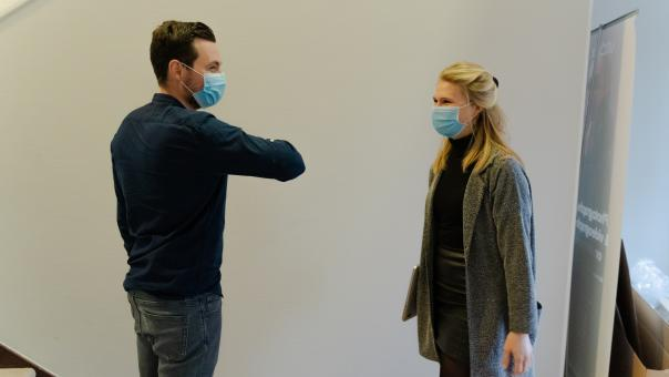 Free Stock Photo of Coworkers With Masks Greeting