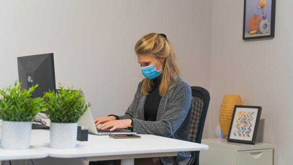 Free Stock Photo of Woman Working in Office with Face Mask