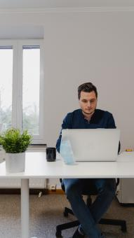 Free Stock Photo of Office Worker not Wearing a Mask