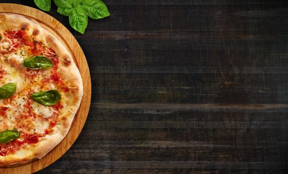 Free Stock Photo of Pizza on Dark Wood Background - With Copyspace
