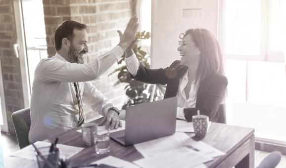 Free Stock Photo of Business Agreement - Business Plan - Man and Woman High-Fiving