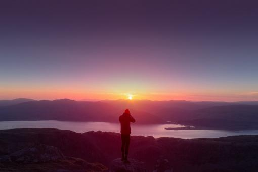 Free Stock Photo of Hiker on Top of Mountain Watching the Sunset - Outdoors