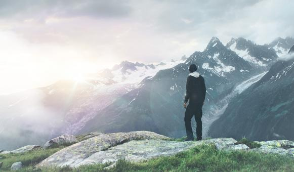 Free Stock Photo of Hiker on Top of Mountain Scanning the Horizon - Outdoors