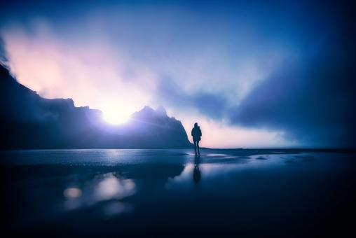 Free Stock Photo of Hiker Alone on Dark Foggy Beach