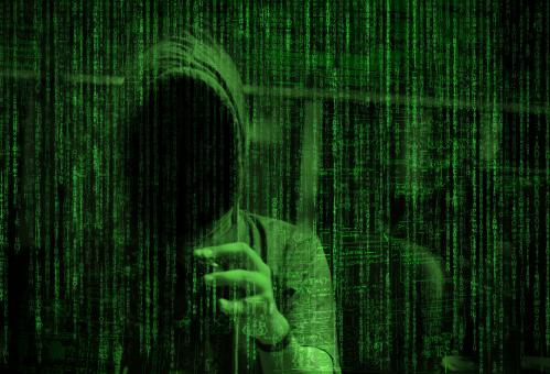 Free Stock Photo of Matrix Over Computer Hacker - Cyber Crime Concept