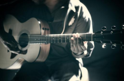 Free Stock Photo of Musician Playing Acoustic Guitar