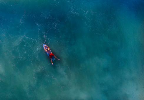 Free Stock Photo of Lone Surfer Waiting for a Wave - Aerial View