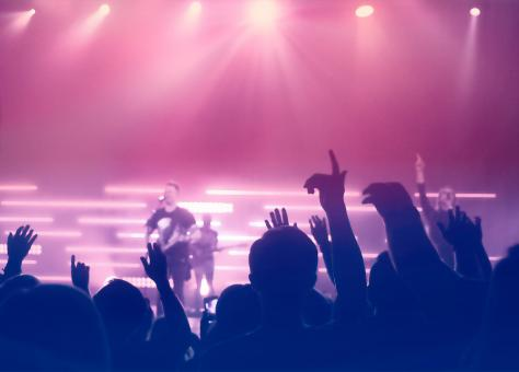 Free Stock Photo of Concert - People Silhouettes Backlit by Stage Lights