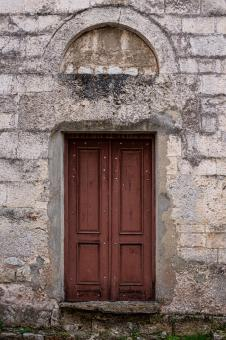 Free Stock Photo of  old door in a stone wall