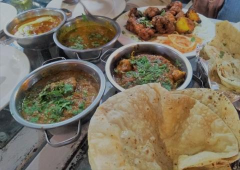 Free Stock Photo of Restaurant table of mixed Indian foods