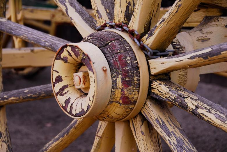 Free Stock Photo of Painted Yellow Wagon Wheel Created by j. l. johnson