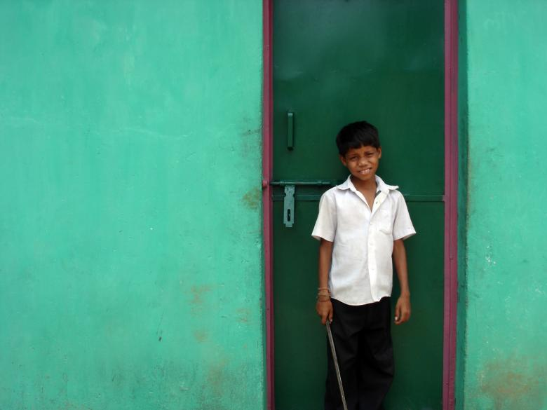 Free Stock Photo of Boy infront of green door Created by saibal datta