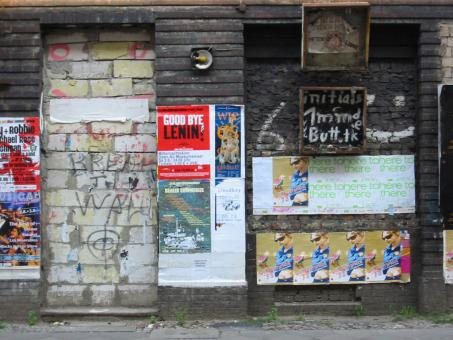 Dirty wall with posters and graffiti - Free Stock Photo