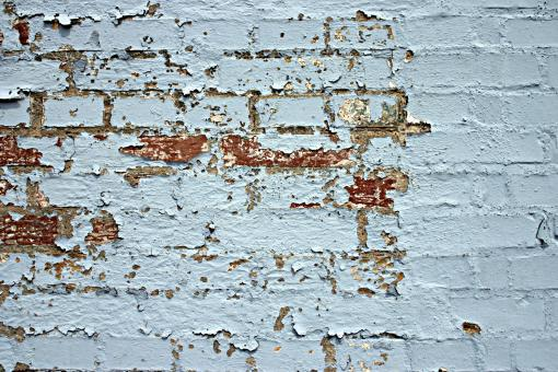 Peeled paint on a brick wall - Free Stock Photo