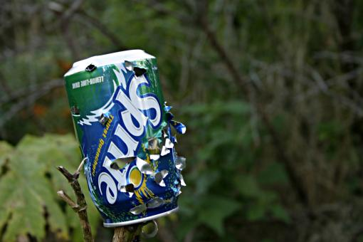 Sprite can with bullet holes - Free Stock Photo