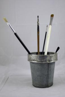 Paint brushes in tin can - Free Stock Photo