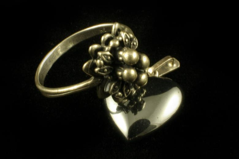 Silver ring and heart Free Photo
