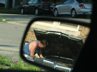 Man fixing Car Free Photo