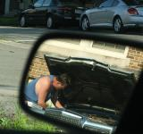 Free Photo - Man fixing Car