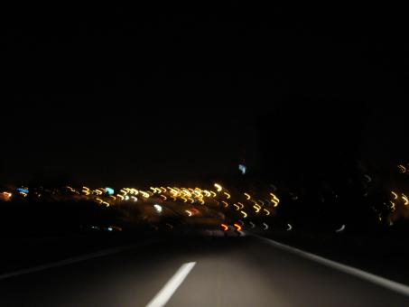 Driving fast at night - Free Stock Photo