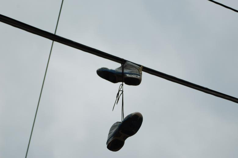 Free Stock Photo of Shoes on a Pylon Created by Mark Manalaysay