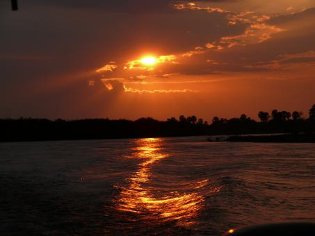 African sunset on river - Free Stock Photo