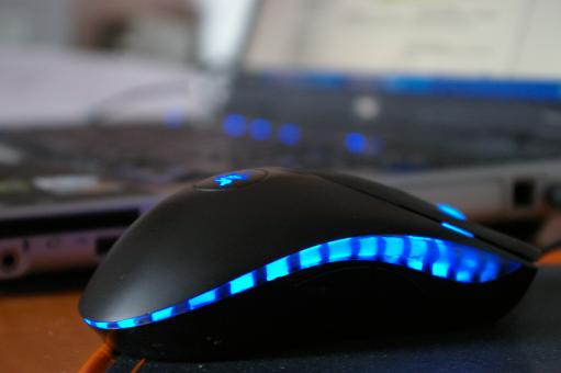 Laptop with blue mouse - Free Stock Photo