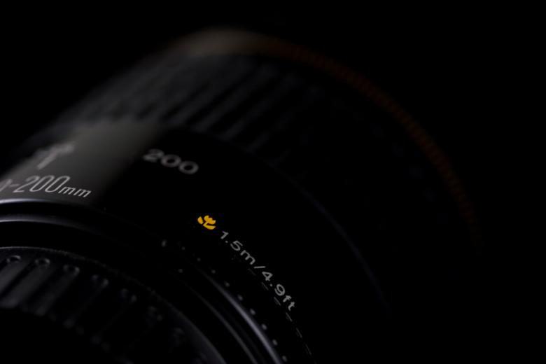 Macro specs on a 200mm lens Free Photo
