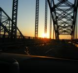 Free Photo - Sun set through a bridge